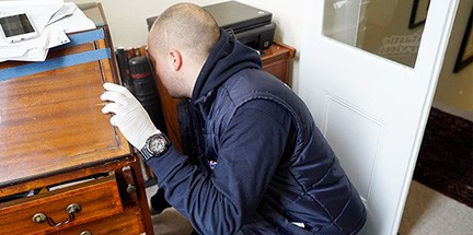 Pest technician proofing a commercial property
